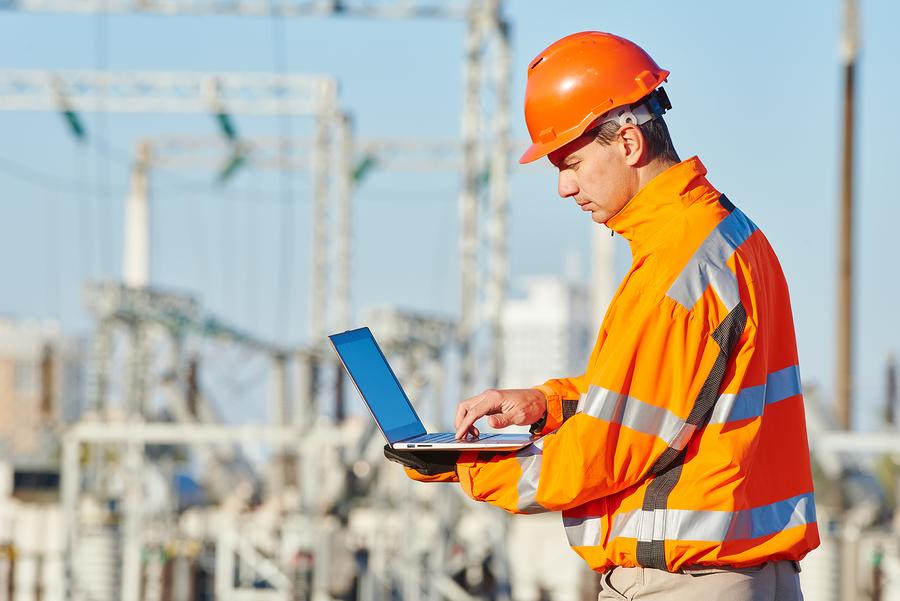 bigstock-engineer-builder-with-laptop-c-109373702